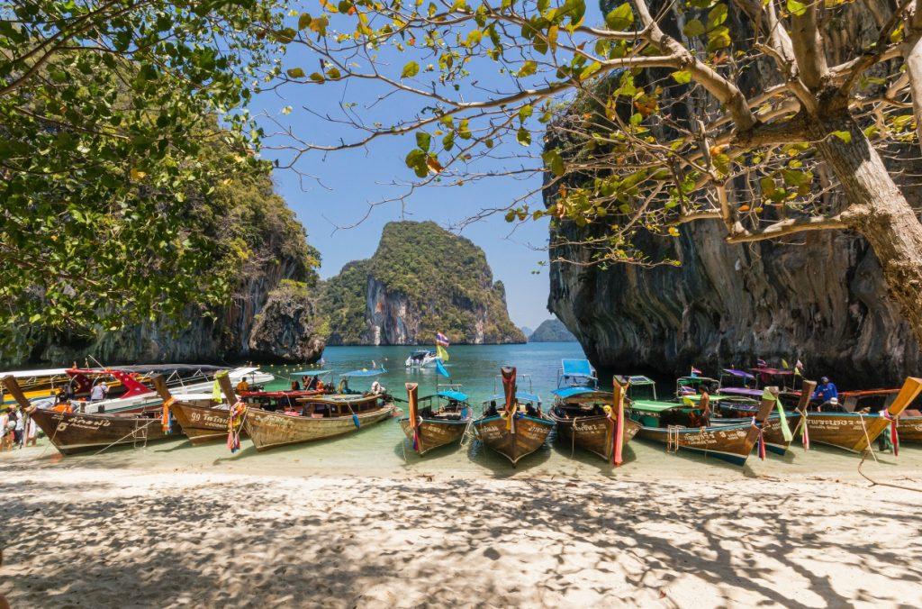Boats parked on a Thai beach