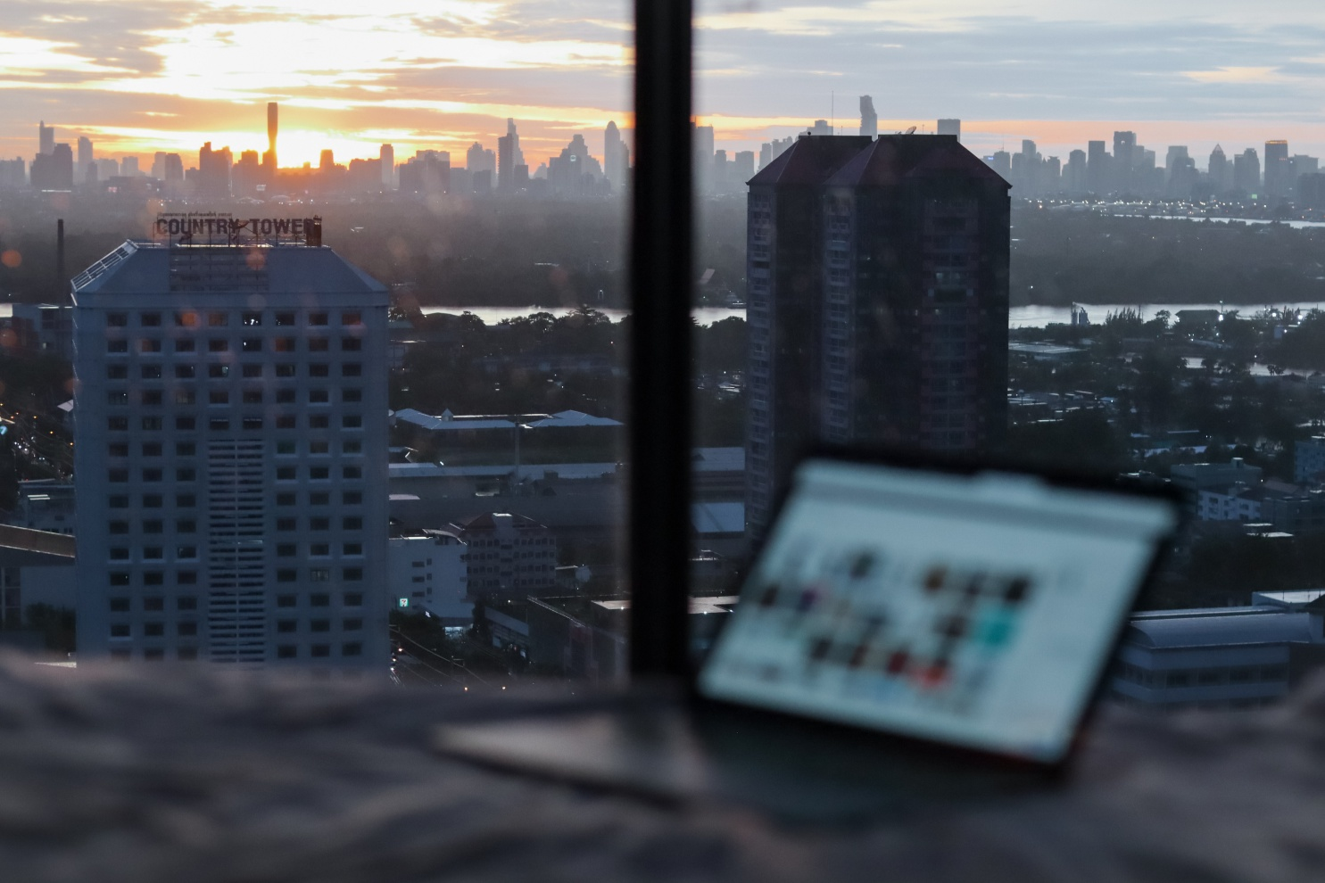 Laptop with skyscrapers in the background